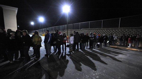 People stand in line  to take advantage of Black Friday sale at Walmart in Bangor Thursday night. The store opened at midnight.