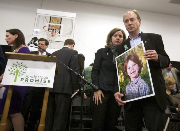 Mark and Jackie Barden, parents of Jack Barden 6, a victim of the December 14, 2012 shooting at Sandy Hook Elementary School, leave the stage following the launch of The Sandy Hook Promise, a non-profit created in response to the shooting in Newtown, Connecticut in this file photo from January 14, 2013.