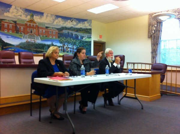Moderator Sarah Newell called on an audience member at a debate between Mark Rosborough, chairman of Ellsworth's withdrawal committee, and Suzanne Lukas,superintendent of RSU 24. The two discussed whether or not Ellsworth should withdraw from the consolidated district at city hall on Tuesday.