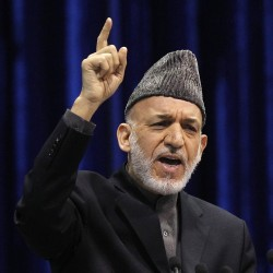 Afghanistan's Karzai said to be in secret talks with Taliban