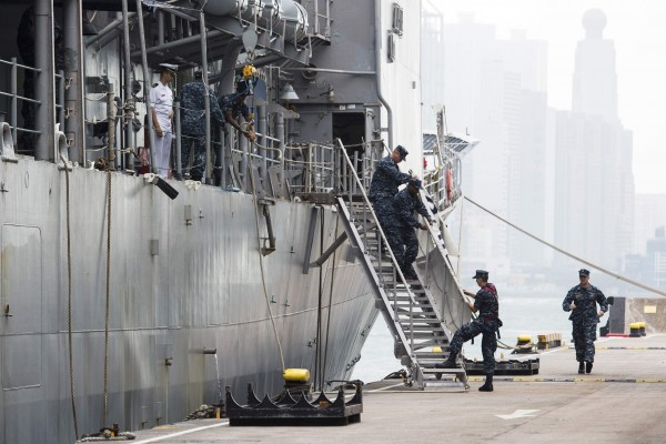 U.S. Navy sailors arrange the ladder of the USS Antietam (CG-54) from the George Washington Battle Group before sailing to the Philippines at Hong Kong Victoria Harbor November 12, 2013. A U.S. aircraft carrier set sail for the Philippines on Tuesday to accelerate relief efforts after a typhoon killed an estimated 10,000 people in one coastal city alone, with fears the toll could rise sharply as rescuers reach more isolated towns.