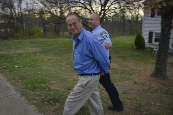 Wayne Houston, foreground, is arrested by the Manassas/Manassas Park/Prince William Narcotics Task Force on Nov. 12, 2013 in Manassas, Va. He is accused of distributing prescription pills illegally.