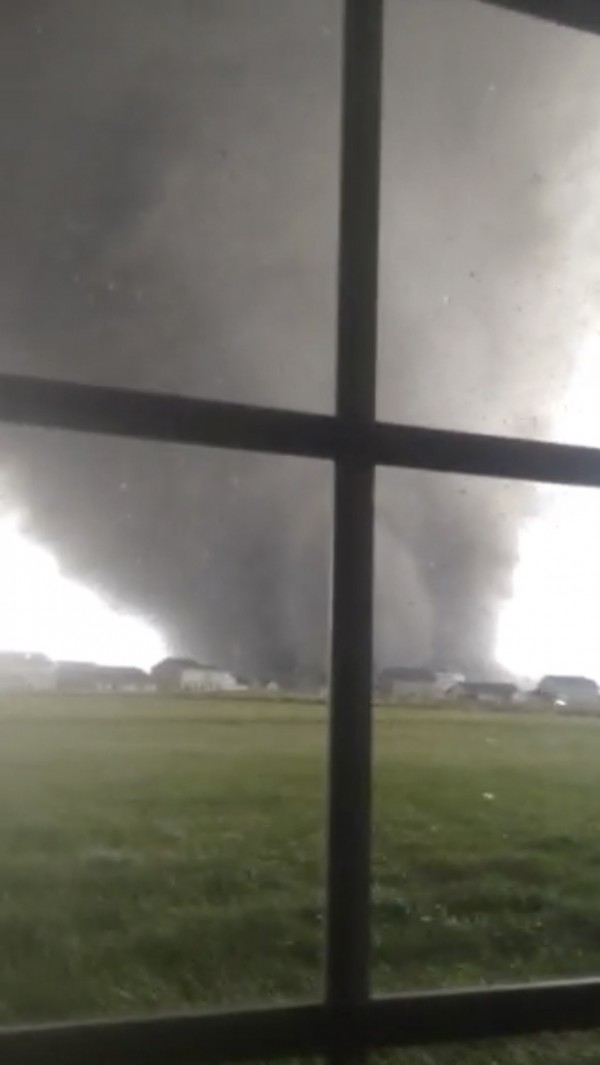An active tornado is seen through a window as it touches down in Washington, Illinois on November 17, 2013, in this still image captured from a video courtesy of Anthony Khoury. A fast-moving storm system spawned multiple tornadoes in Illinois and Indiana, threatening some 53 million people across 10 Midwestern states on Sunday, U.S. weather officials said. Washington, Illinois is located 145 miles (233 km) southwest of Chicago.