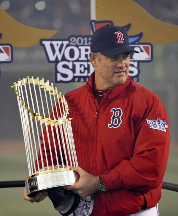 Boston Red Sox manager John Farrell holds the World Series championship trophy after game six of the MLB baseball World Series against the St. Louis Cardinals at Fenway Park. The Red Sox won 6-1 to win the series four games to two.