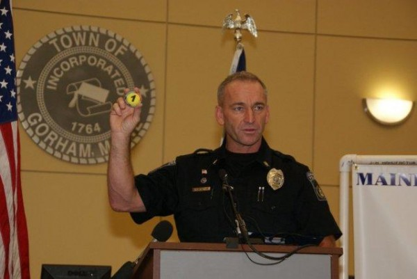 Officer Ted Hatch of the Gorham Police Department announces the launch of the Yellow Dot Program in Cumberland County in October 2012. Participants place a yellow sticker on their car to alert first responders that a packet of vital information, such as lists of allergies and medications, is in the glove box in the event of an emergency.