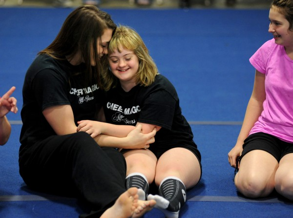 Instructor Heather Tupper (left) shares a moment with Ciarra Boucher, a student at Big 10 Cheer in Hermon. Ciarra, a freshman at Brewer High School, is one of 11 students on the Cheer Magic All Stars special needs team at Big 10 Cheer. At right is Sydney Newcomb, a 7th grader at Holbrook in Holden.