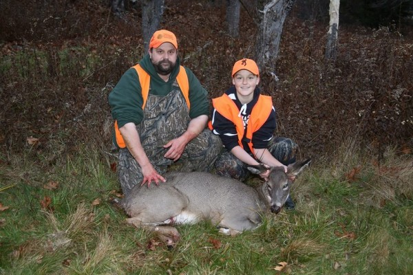 Sierra Wallace, 13, and her father Troy Wallace, both of Phippsburg, pose with the deer Sierra shot on Nov. 16, 2013. The deer completed a hunting grand slam for Sierra, who shot a bear, a moose, a turkey and a bear this season.