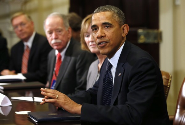 President Barack Obama meets with health insurance chief executives at the White House in Washington Nov. 15, 2013.
