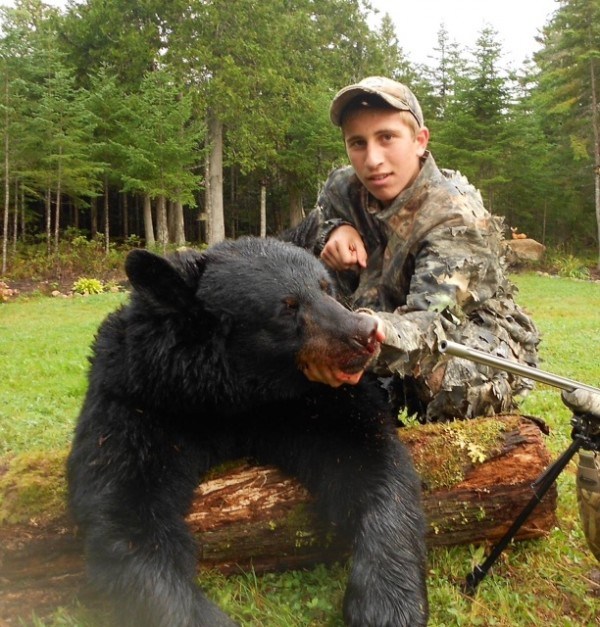 Kamden Brown, 15, of Skowhegan shot this 303-pound black bear en route to completing a hunting grand slam this year. Brown tagged a wild turkey, a deer, a moose and the bear during the 2013 season.