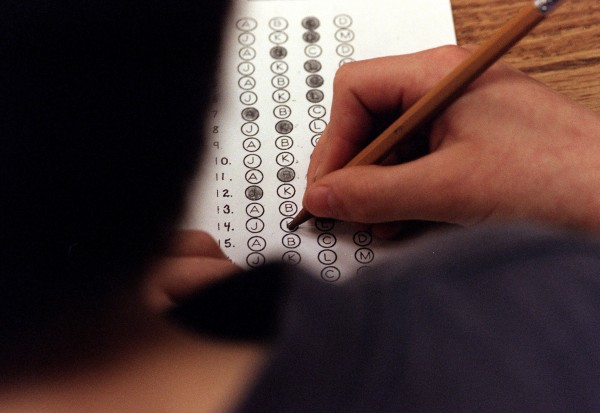In this March 12, 1999 file photograph, a student fills in his answer to the practice test question for a standardized test, in Roswell, Georgia.