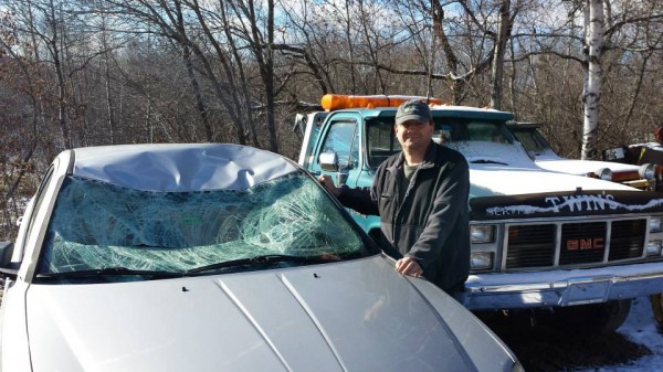 Sen. Troy Jackson stands next to his car that was totaled after he hit a moose on Route 161 this week. In 2009 the Allagash Democrat introduced legislation to expand Maine's moose hunt in an attempt to cut down on moose-vehicle accidents. That legislation became law in 2010.