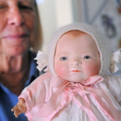 Anne Sleeper with the doll that started it all. Sleeper is the president of Maine-ly Doll Club.