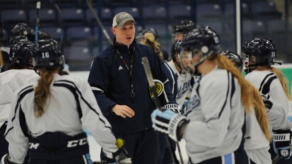 Coach Richard Reichenbach talks to the University of Maine women's ice hockey team during a practice Tuesday at Alfond Arena. Reichenbach and his wife, Sara Simard Reichenbach, are the interim head coaches of the team.
