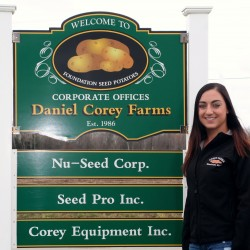 Sara Corey poses at Corey Farms in Monticello, the family farm where she grew up and now works as director of agronomy and variety development. The Maine Potato Board named her 2013 Young Farmer of the Year. At 23 years old, Corey is the first woman to be chosen for this recognition and is the youngest recipient of the honor.