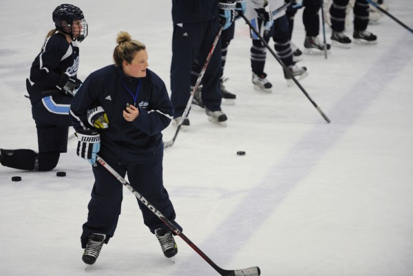 University of Maine women's ice hockey coach Sara Simard Reichenbach watches her team participate in a drill Tuesday at Alfond Arena. She and her husband, Richard Reichenbach, are the team's interim co-head coaches.