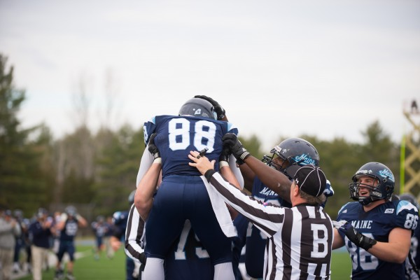 The University of Maine's Damarr Aultman celebrates with teammates after scoring a touchdown in Saturday's game against the University of Rhode Island at Alfond Stadium in Orono. The Black Bears won 41-0.