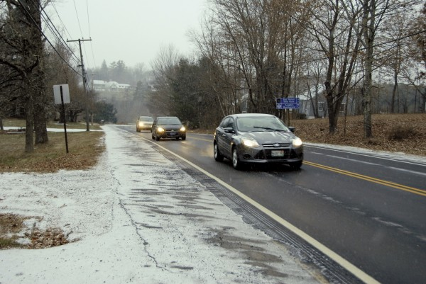 The season's first accumulating snowfall caught most motorists by surprise Tuesday while greasing local highways and byways, such as Main Road North in Hampden.