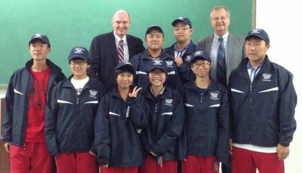 Shengli No. 1 High School in Dongying, China, is  up and running with eight students attending the Presque Isle international school. According to SAD 1 Superintendent Gehrig Johnson (back left), three more international schools are scheduled to start in the fall of 2014, and the district will receive a percentage of the tuition on a per-pupil basis. Johnson and Business Manager Charles Anderson (back right) traveled to China for the second time in October, when they visited with teachers, students and parents. Posing with the administrators, the Chinese students sport their new Presque Isle Wildcat hats and jackets.