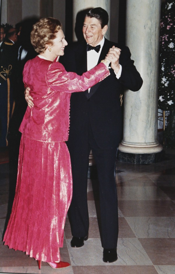 President Ronald Reagan and Prime Minister Margaret Thatcher take a spin around the dance floor in the foyer of the White House during a State Dinner in the Prime Minister's honor in this Nov. 16, 1988, file photo.