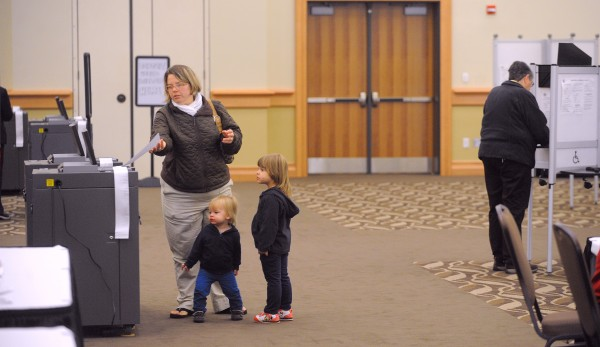 Kristine Stone of Bangor (left) came to vote at the Cross Insurance Center Tuesday with her children 18-month-old son Jacob (center) and three-year-old daughter Mackenzie.