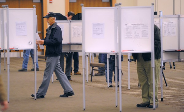 People vote at the Cross Insurance Center in Bangor Tuesday morning.