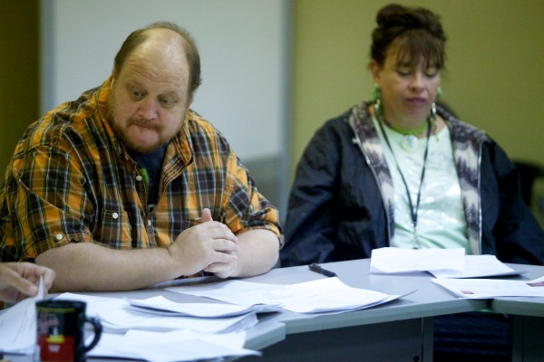 Thomas Ptacek, along with Mary Jo Skofield, listens to a report at the Emergency Shelter Assessment Committee in Portland in September.
