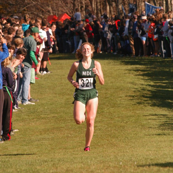 Mount Desert Island's Waylon Henggeler gives it her all as she nears the finish line in the state Class B cross country championships Saturday at Cumberland.
