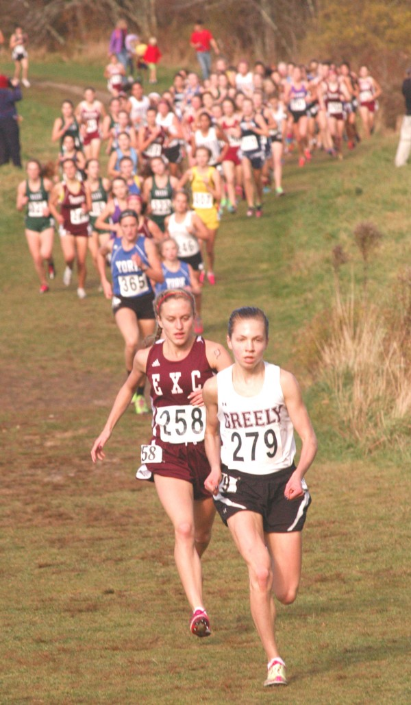 Ellsworth High School's Aleta Looker (258) and Greely's Kirstin Sandreuter (279) took the early lead in the state Class B cross country championships Saturday in Cumberland. Sandreuter went on to win in 18 minutes, 37.96 seconds while Looker was second in 19:49.43.