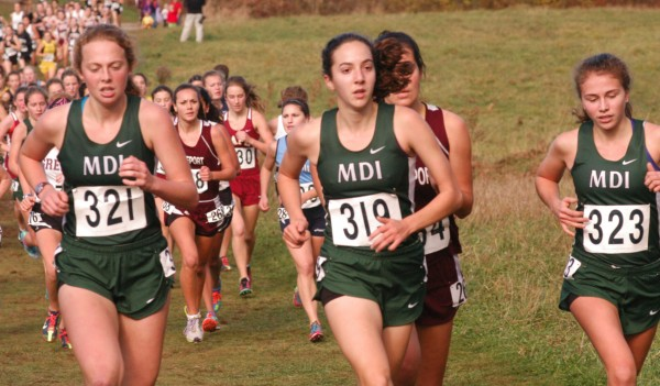 Mount Desert Island runners Waylon Henggler (321), Isabel Erickson (319) and Maggie Painter (323) compete during the state Class B cross country championships Saturday in Cumberland.