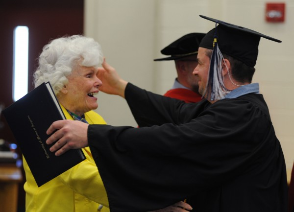 Inmate Steven Clark embraces Doris Buffet, sister of billionaire Warren Buffett , who heads the Sunshine Lady Foundation that made it possible for 14 inmates to get a university degree from the University of Maine at Augusta on Monday at the Maine State Prison.