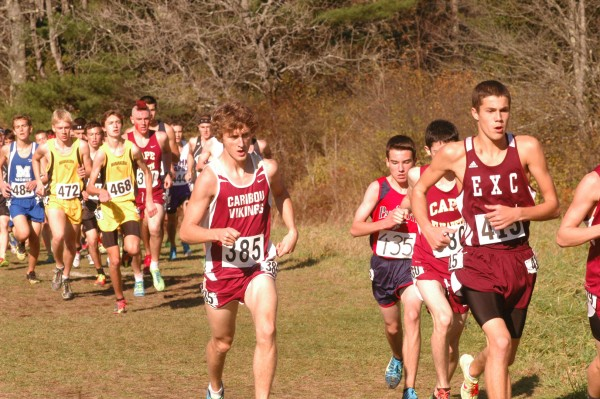 Caribou's Lucas Kinney (385) has a lot of company as he competes in the state Class B cross country championships Saturday in Cumberland.