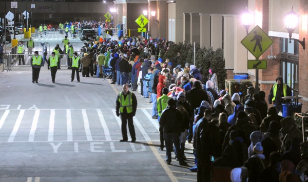 People stand in line to take advantage of Black Friday sale at the Walmart store in Bangor Thursday night.  The store opened at midnight.