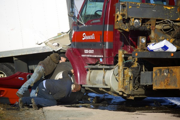 A Stewart's tow truck carrying a Pine Tree Services truck, both from Orrington, collided with a CDS Delivery truck Friday morning near the intersection of Banair Road and Hammond Street Extension in Bangor.