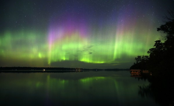 A spectacular display of northern lights filled the sky over Lake Elora in northern Minnesota early Sunday morning on July 15, 2012. A solar storm sparked the show in the skies over the Upper Midwest.