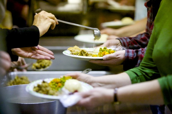 Volunteers serve a free Thanksgiving meal prepared by Manna Ministries Thursday morning at Columbia Street Baptist Church in Bangor.
