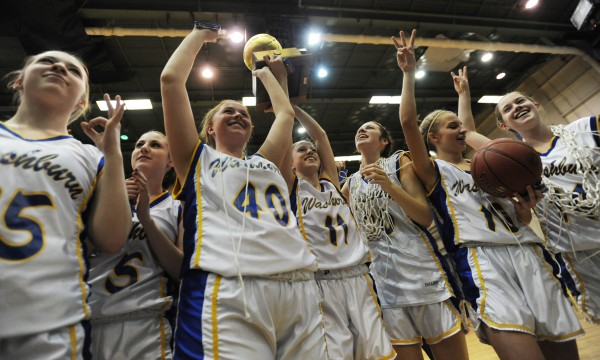 Washburn's girls basketball team celebrates with the gold ball after defeating Richmond 75-55 during class D state championship action in March at the Bangor Auditorium.