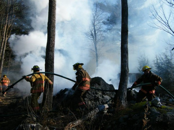 Firefighters battle a blaze on Old Boot Road in Orland on Thursday morning.
