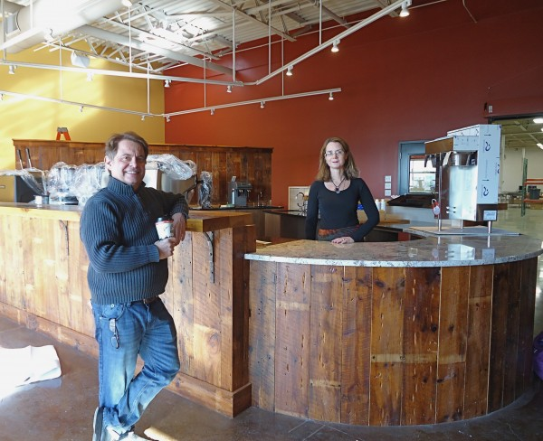 Coffee By Design's new cafe will be a lab for coffee aficionados. Opening in January, it will showcase the latest brew techniques. Like a brewery, customers can see their beans being roasted through a garage door windor. Owners Alan Spear and Mary Allen Lindemann say their new headquarters help them compete while staying fiercely local.