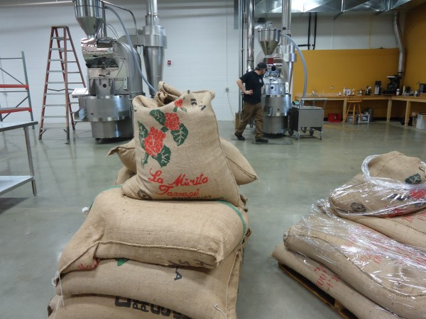 Coffee beans await high-end, smokeless roasters at Coffee By Design's new East Bayside headquarters.