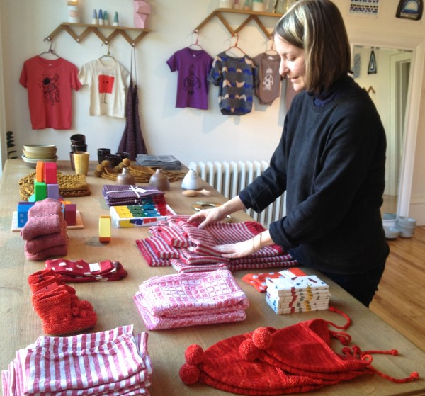 Maria Vettese of More & Co. in Portland preps her shop for Small Business Saturday.