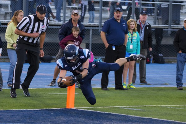 John Ebeling of the University of Maine, pictured scoring a touchdown in the Black Bears' October 5 game against Delaware, had two big catches on UMaine's winning scoring drive Saturday in a 19-14 victory over Stony Brook at Alfond Stadium in Orono.