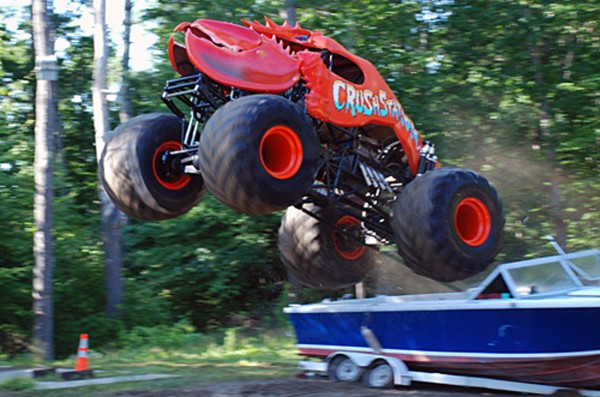 Crushstation, the moster truck driven by Jefferson's Greg Winchenbach, rolls over a motor boat during an early test run in 2009.