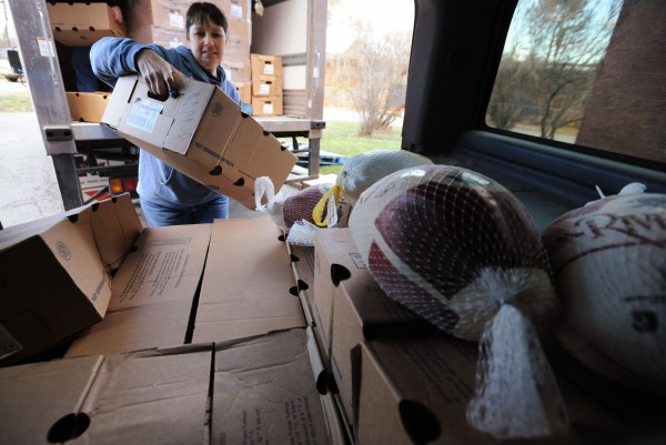 Carol Lackedy loads boxes of frozen turkeys from a box truck into her SUV in the parking lot of Manna in Bangor on Saturday. Lackedy and Shawn Cowan run Neighbors Supporting Neighbors, a food pantry, in Hermon. The pair will distribute turkeys to needy families for Thanksgiving.