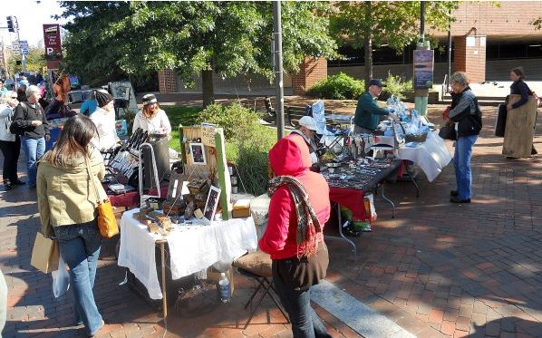Artists and craftmakers sell their wares on Commercial Street in Portland in this 2011 Bangor Daily News file photo.