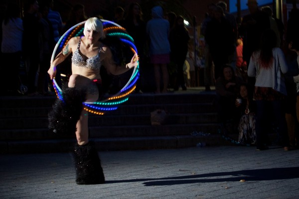 Burlesque performer Alexis Golubow dances in Portland's Congress Square Park in September protesting the possible sale of the park to a private developer.