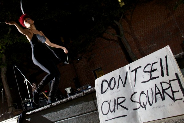 Burlesque performer Aquarius Funkk dances in Portland's Congress Square Park in September protesting the possible sale of the park to a private developer.