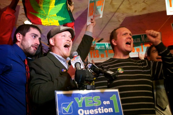 Leaders of the campaign to legalize marijuana in Portland celebrate their victory Tuesday night. From left are David Boyer, David Marshall and Tom MacMillan.