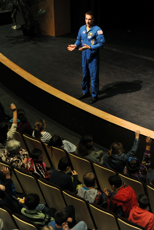 NASA astronaut and former Maine resident Christopher Cassidy speaks to students from 14 area middle schools on Thursday morning at Husson University's Gracie Theater. Cassidy recently returned from 6 months aboard the Interanational Space Station and is speaking to kids about the future of manned space flight, his experiences and the importance of education.