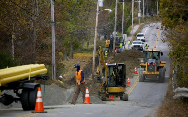 Bangor Gas and other construction crews prepare the side of Bennoch Road for natural gas pipeline installation in Orono last month.