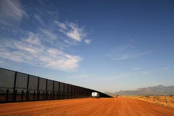 A U.S. Border vehicle drives along the U.S. and Mexico border fence in Naco, Arizona, in this September 7, 2011 file photo.
